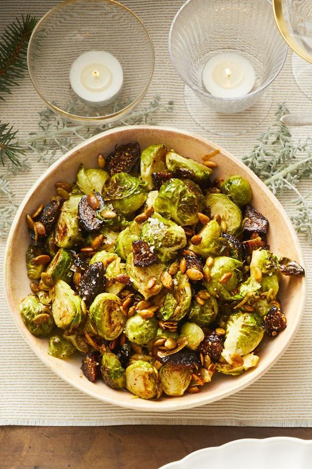 """<p>These aren't any boring Brussels sprouts. Pack this vegetable side dish with crunchy pumpkin seeds and dried figs for the ultimate partner to your Christmas ham.</p><p><em><a href=""""https://www.goodhousekeeping.com/food-recipes/healthy/a25323337/brussels-sprouts-with-pepitas-and-figs-recipe/"""" target=""""_blank"""">Get the recipe for Brussels Sprouts with Pepitas and Figs »</a></em></p><p><strong>RELATED: </strong><a href=""""https://www.goodhousekeeping.com/holidays/christmas-ideas/g4019/best-christmas-hams/"""" target=""""_blank"""">21 Gorgeous Glazed Hams for Your Christmas Table </a></p>"""