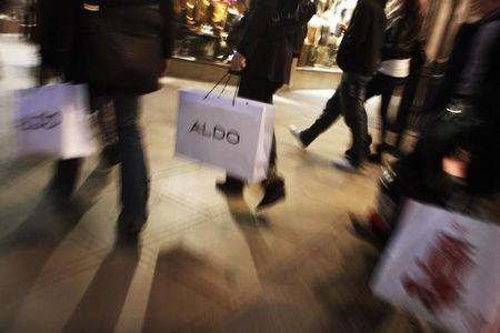 FILE PHOTO - People carry shopping bags on Oxford Street in London, December 13, 2011. REUTERS/Finbarr O'Reilly