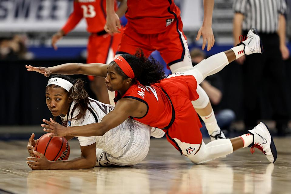 SAN ANTONIO, TEXAS - MARCH 27: Aaliyah Wilson #2 of the Texas A&M Aggies and Aari McDonald #2 of the Arizona Wildcats fight for the loose ball in the first half during the Sweet Sixteen round of the NCAA Women's Basketball Tournament at the Alamodome on March 27, 2021 in San Antonio, Texas. (Photo by Elsa/Getty Images)