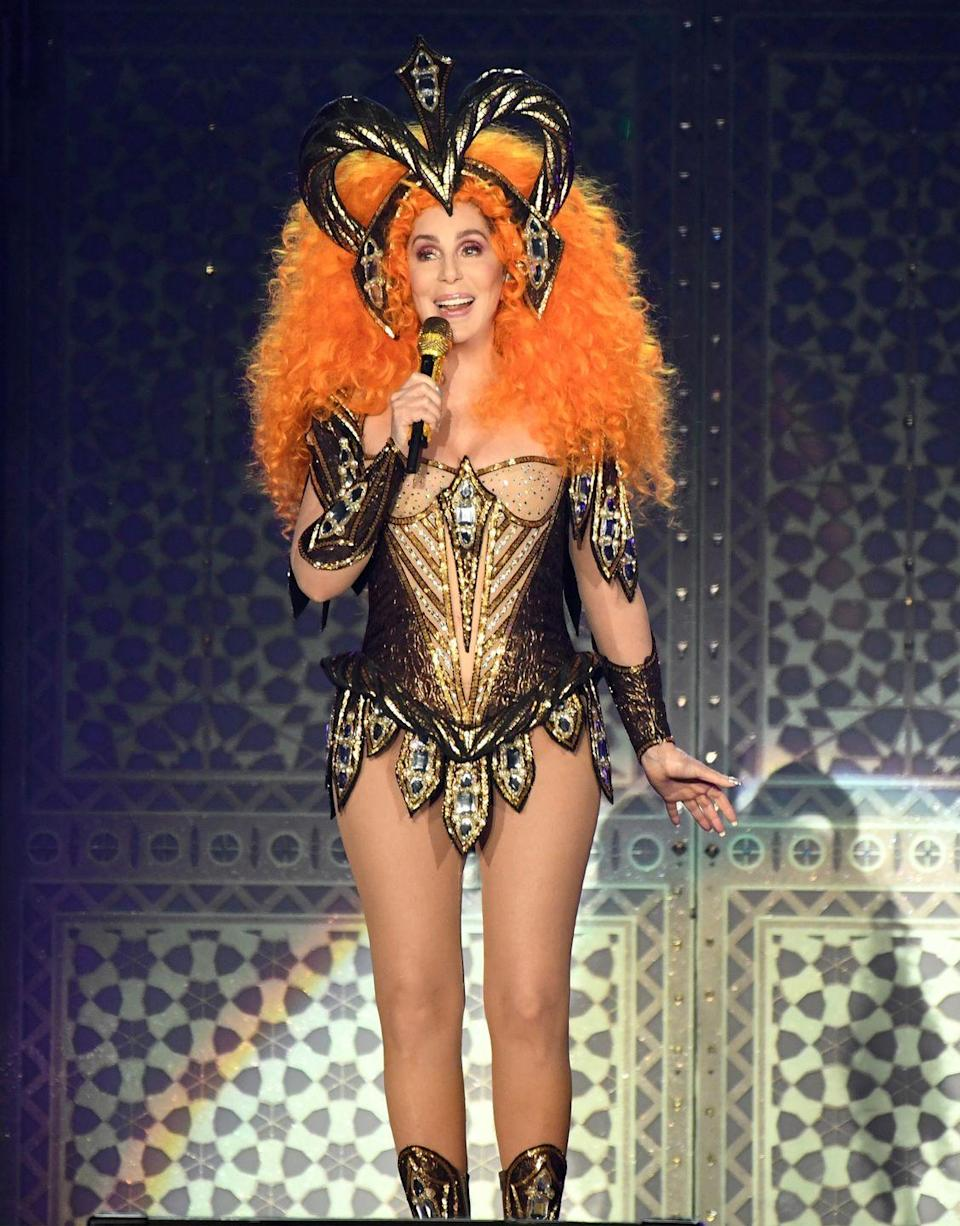<p>Opening her 2019 'Here We Go Again' tour in a gladiator-inspired bodysuit and giant orange wig. </p>