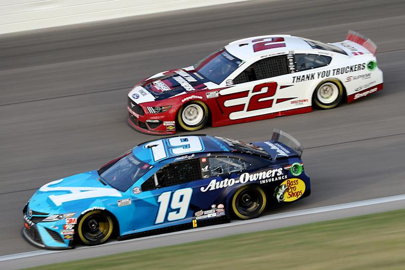 KANSAS CITY, KANSAS - JULY 23: Martin Truex Jr., driver of the #19 Auto Owner's Insurance Toyota, races Brad Keselowski, driver of the #2 Wabash Ford, during the NASCAR Cup Series Super Start Batteries 400 Presented by O'Reilly Auto Parts at Kansas Speedway on July 23, 2020 in Kansas City, Kansas. (Photo by Jamie Squire/Getty Images)