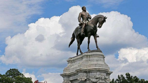 PHOTO: FILE - This Tuesday June 27, 2017 file photo shows the Statue of Confederate General Robert E. Lee that stands in the middle of a traffic circle on Monument Avenue in Richmond, Va., June 27, 2017. (Steve Helber/AP, File)