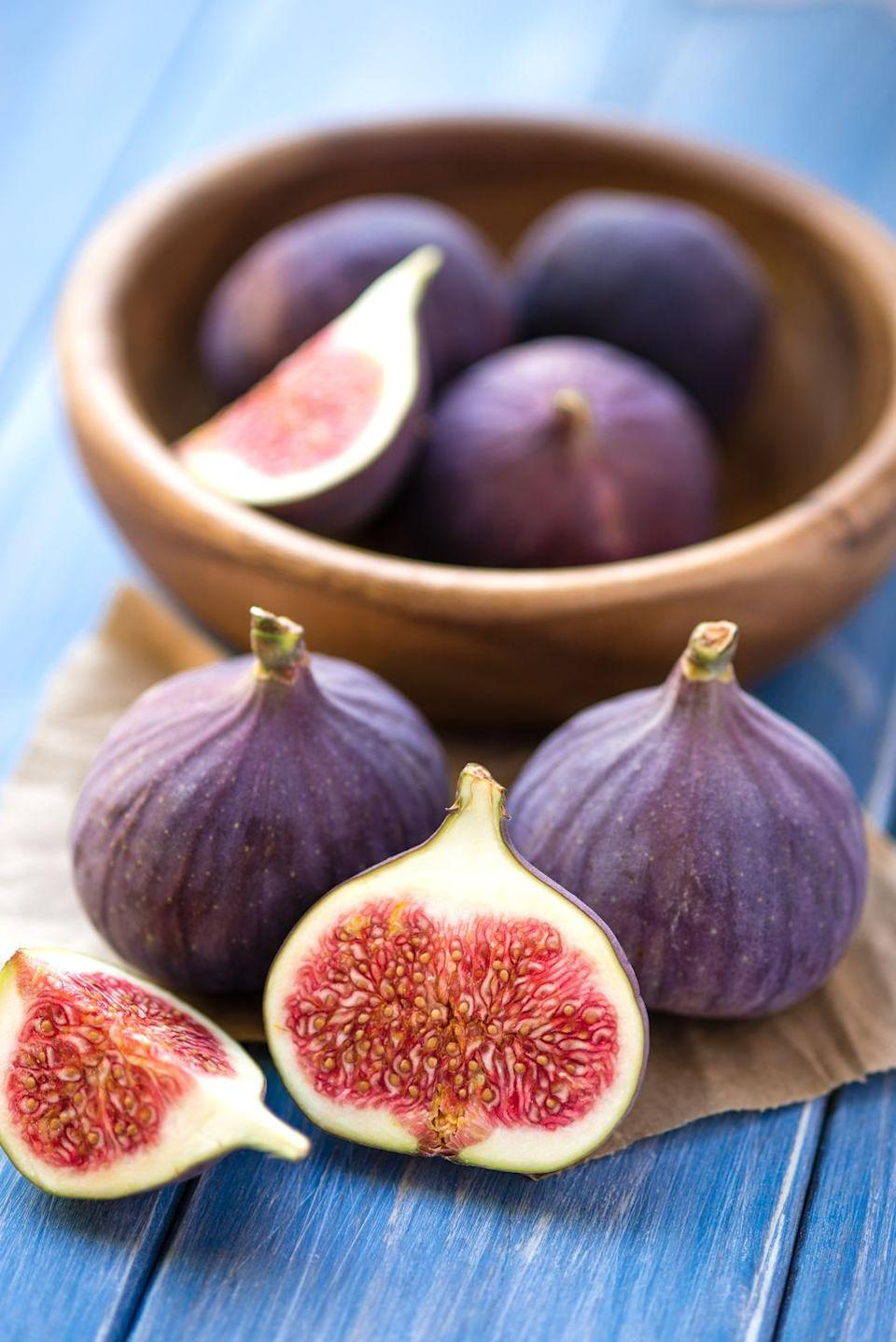 """<p>""""Figs pack potassium, magnesium, calcium, and iron,"""" says <a href=""""https://www.goodhousekeeping.com/author/11834/jaclyn-london-ms-rd-cdn/"""" rel=""""nofollow noopener"""" target=""""_blank"""" data-ylk=""""slk:Jaclyn London, MS, RD, CDN"""" class=""""link rapid-noclick-resp"""">Jaclyn London, MS, RD, CDN</a>. """"These minerals help with blood flow and muscle contraction, which are key for falling asleep."""" Besides crushing your dessert craving, each fig also packs some additional fiber that'll keep you full.</p>"""