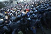 FILE - In this Jan. 23, 2021, file photo, people in St. Petersburg, Russia, clash with police while protesting the jailing of opposition leader Alexei Navalny. Rattled by the nationwide demonstrations in support of the Kremlin foe, authorities are moving rapidly to block any new ones – from piling legal pressure on his allies to launching a campaign to discredit the demonstrations. (AP Photo/Dmitri Lovetsky, File)