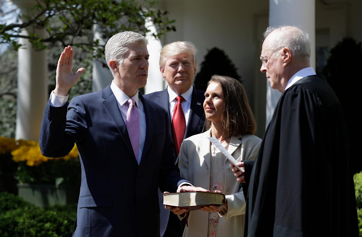 Neil Gorsuch took the oath as a Supreme Court justice in the White House Rose Garden in April 2017, accompanied by President Trump, Associate Justice Anthony Kennedy, and Gorsuch's wife, Louise.
