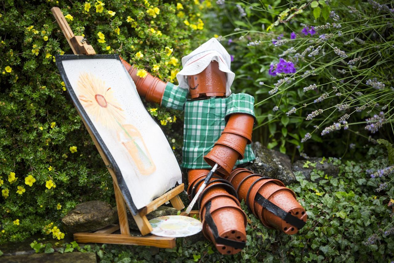 <p>Settle Flowerpot Festival in Settle in the Yorkshire Dales, U.K. on Aug. 7, 2017. The festival was started in 2004 & takes place throughout August, it see's local residents make a variety of creation's all made with flower pots. (Photo: Andrew McCaren/LNP/REX/Shutterstock) </p>