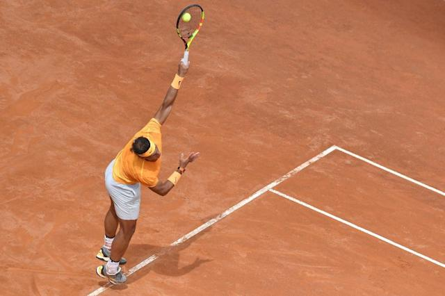 Rafael Nadal powered his way into the third round of the ATP Italian Open on Wednesday with a straight sets win over Bosnian Damir Dzumhur (AFP Photo/Andreas SOLARO)