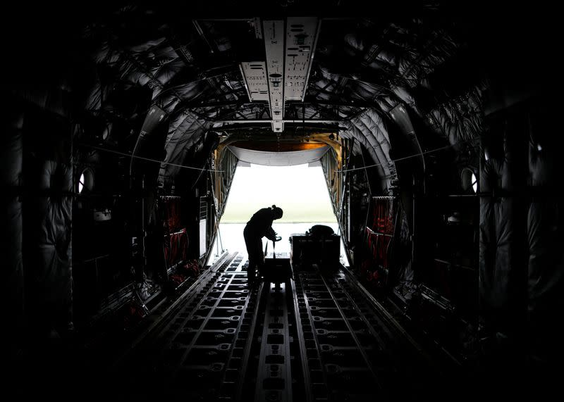 A U.S. soldier wearing a protective face mask is seen inside a C-130 transport plane during a military drill amid the coronavirus disease (COVID-19) outbreak, at Yokota U.S. Air Force Base in Fussa, Japan