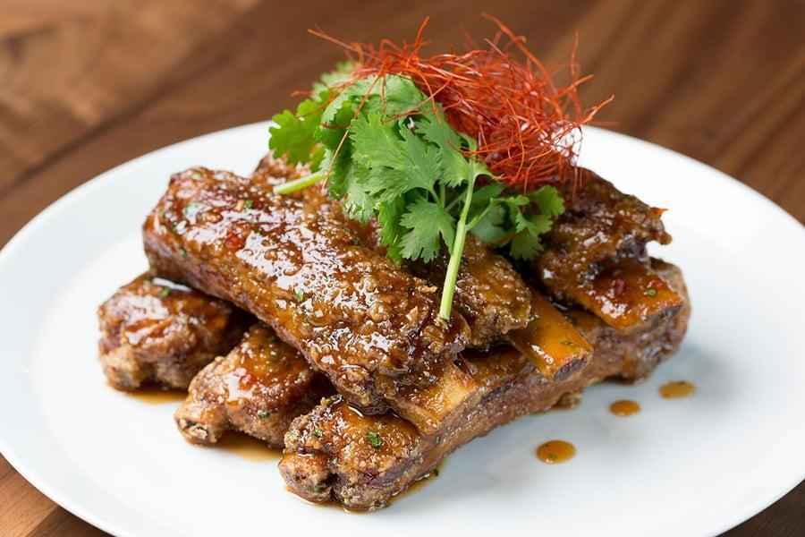"<p>These ribs from Morimoto Asia at Disney Springs are deceivingly easy and a major crowd pleaser. The sauce is a little spicy, but it will definitely keep you coming back for more.</p> <p><strong>Get the recipe:</strong> <a href=""http://disneyparks.disney.go.com/blog/2015/11/morimoto-asias-hoisin-sticky-spare-ribs-recipe-for-cook-something-bold-day-nov-8/"" class=""link rapid-noclick-resp"" rel=""nofollow noopener"" target=""_blank"" data-ylk=""slk:Disney's hoisin sticky spare ribs"">Disney's hoisin sticky spare ribs</a></p>"