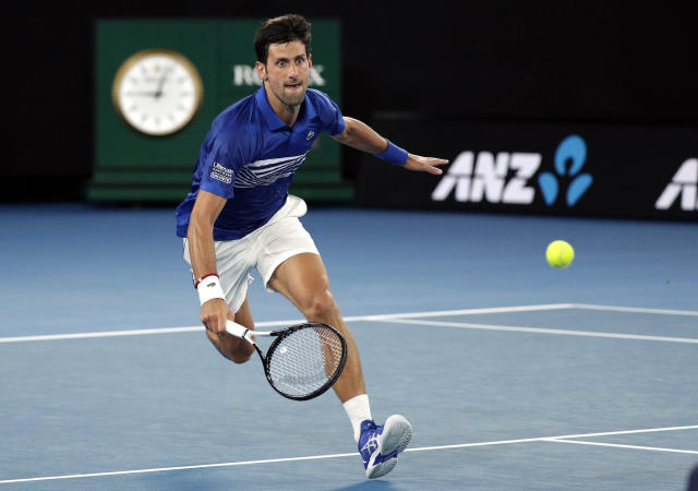 Serbia's Novak Djokovic runs to make a forehand return to United States' Mitchell Krueger during their first round match at the Australian Open tennis championships in Melbourne, Australia, Tuesday, Jan. 15, 2019. (AP Photo/Kin Cheung)