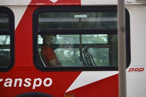 Masks will continue to be required aboard transit and in other enclosed public spaces until at least Aug. 26, Ottawa city council decided Wednesday. (Andrew Lee/CBC - image credit)