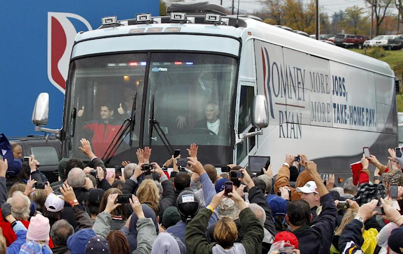 Republican vice presidential candidate, Rep. Paul Ryan, R-Wis., left in front of bus, gives a thumbs-up to supporters as he arrives for a campaign rally at the Valley View Campgrounds in Belmont, Ohio, Saturday, Oct. 20, 2012, where he talked about economic conditions and the coal industry. (AP Photo/Keith Srakocic)