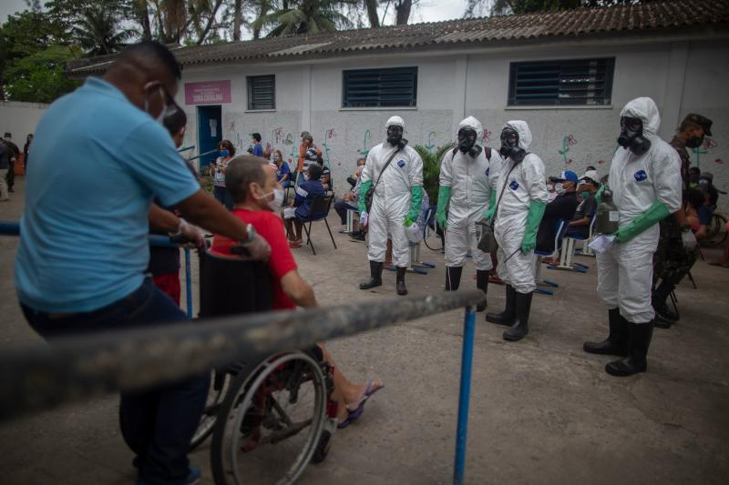 Brazil's Armed Forces soldiers prepare to disinfect the public shelter Stella Maris as a measure to combat the outbreak of new novel coronavirus (COVID-19), in Rio de Janeiro, Brazil, on May 14, 2020. (Photo by MAURO PIMENTEL / AFP) (Photo by MAURO PIMENTEL/AFP via Getty Images)