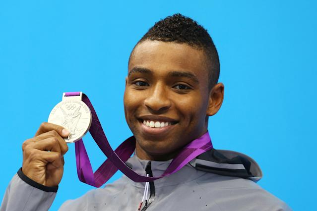 LONDON, ENGLAND - AUGUST 03: Silver medallist Cullen Jones of the United States poses on the podium during the medal ceremony for the Men?s 50m Freestyle Final on Day 7 of the London 2012 Olympic Games at the Aquatics Centre on August 3, 2012 in London, England. (Photo by Al Bello/Getty Images)