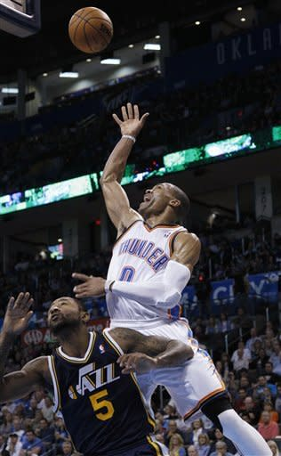 Oklahoma City Thunder guard Russell Westbrook (0) releases a shot over Utah Jazz guard Mo Williams (5) in the second quarter of an NBA basketball game in Oklahoma City, Friday, Nov. 30, 2012. (AP Photo/Sue Ogrocki)