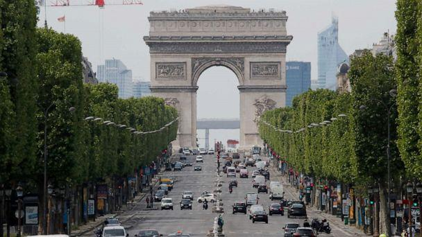 PHOTO: Cars drive on the Champs Elysee avenue, with a view of the Arc de Triomphe in the background, in Paris, France, on May 7, 2020. (Christophe Ena/AP)