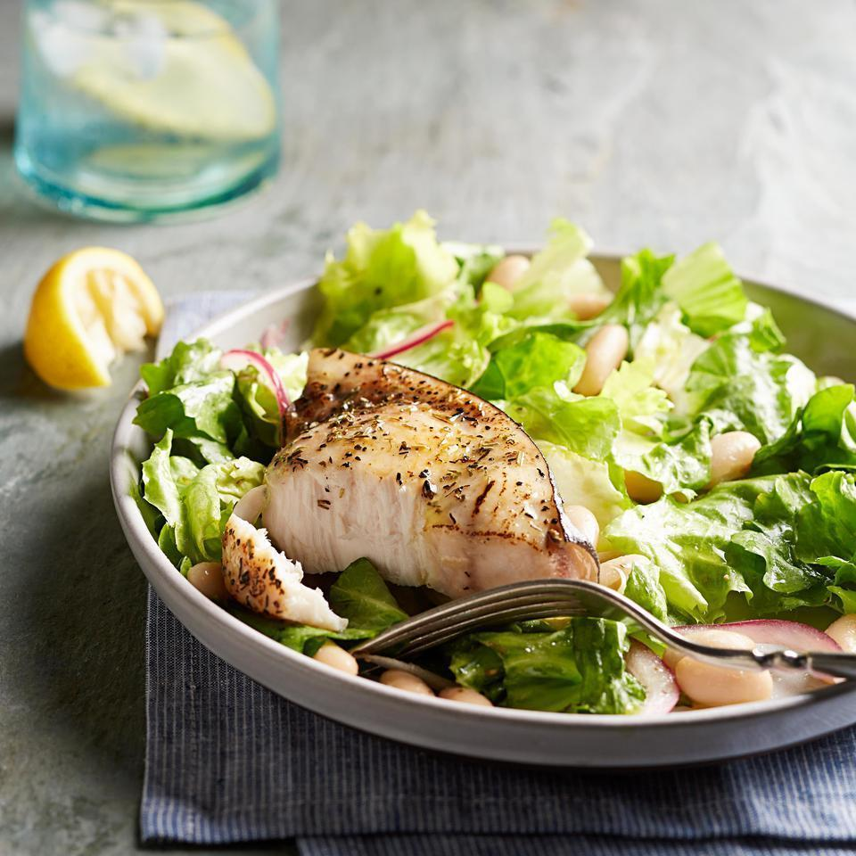 "<p>In this healthy fish recipe, meaty swordfish gets a dusting of herbs before being pan-seared. Then it's served on top of a healthy escarole and white bean salad with a lemon-Dijon vinaigrette. <a href=""http://www.eatingwell.com/recipe/251345/escarole-white-bean-salad-with-swordfish/"" rel=""nofollow noopener"" target=""_blank"" data-ylk=""slk:View recipe"" class=""link rapid-noclick-resp""> View recipe </a></p>"