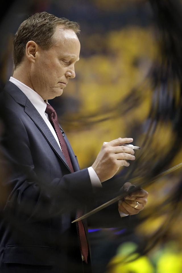 Atlanta Hawks head coach Mike Budenholzer writes on a whiteboard in the first half during Game 7 of a first-round NBA basketball playoff series against the Indiana Pacers in Indianapolis, Saturday, May 3, 2014. The Pacers won 92-80. (AP Photo/AJ Mast)