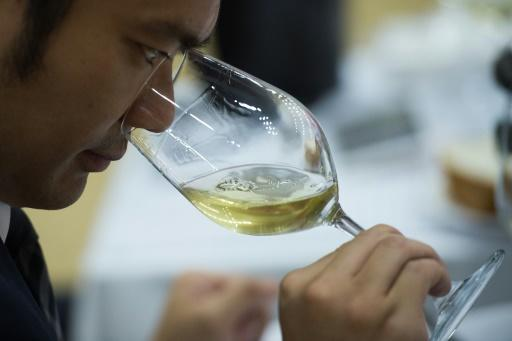 An expert tastes wine during the 2018 Concours Mondiale de Bruxelles at a hotel resort in Beijing