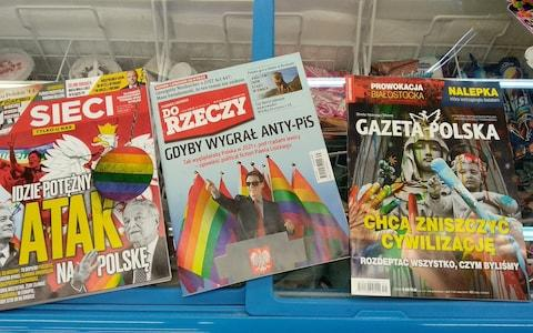 "Conservative magazines have run covers warning of an ""attack"" on Poland coming from the LGBT community - Credit: Peter Foster/The Telegraph"