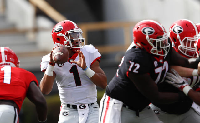 """Quarterback <a class=""""link rapid-noclick-resp"""" href=""""/ncaaf/players/287612/"""" data-ylk=""""slk:Justin Fields"""">Justin Fields</a> throws a pass during during the first half of Georgia's annual G Day inter squad spring football game Saturday, April 21, 2018, in Athens, Ga. (AP Photo/John Bazemore)"""
