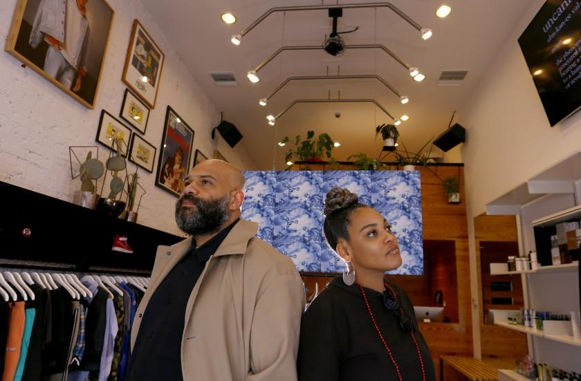 """Chris Gibbs and his wife Beth Birkett at their store Union on La Brea Avenue in Los Angeles. That store, and Birkett's clothing line, Bephie, are among the local black-owned businesses on our list. <span class=""""copyright"""">(Luis Sinco / Los Angeles Times)</span>"""