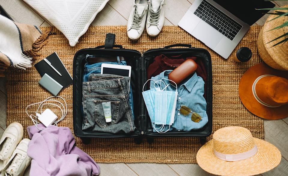 Packing light can be a challenge, but these products are my go-tos for dealing with limited luggage. (Getty Images)