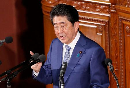 Japan's Prime Minister Shinzo Abe makes a speech at an opening of a new session of parliament in Tokyo