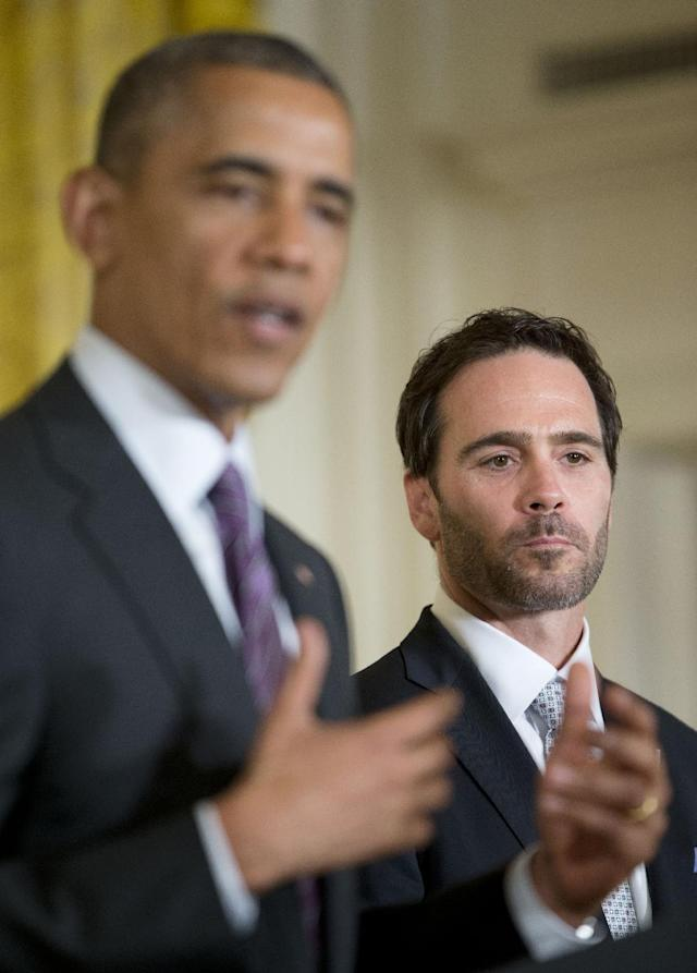 Jimmie Johnson listens as President Barack Obama speaks during a ceremony honoring 2013 NASCAR Sprint Cup Series champions, Wednesday, June 25, 2014, in the East Room of the White House in Washington. (AP Photo/Pablo Martinez Monsivais)