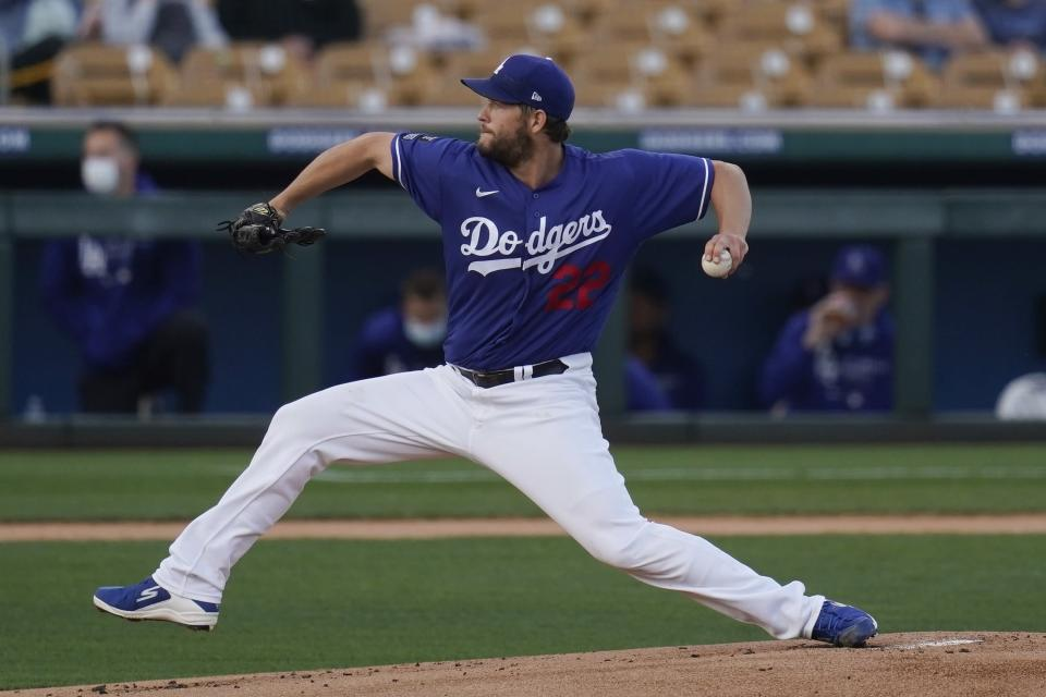 Los Angeles Dodgers starting pitcher Clayton Kershaw throws to an Oakland Athletics batter during the first inning of a spring training baseball game Friday, March 26, 2021, in Phoenix. (AP Photo/Ross D. Franklin)