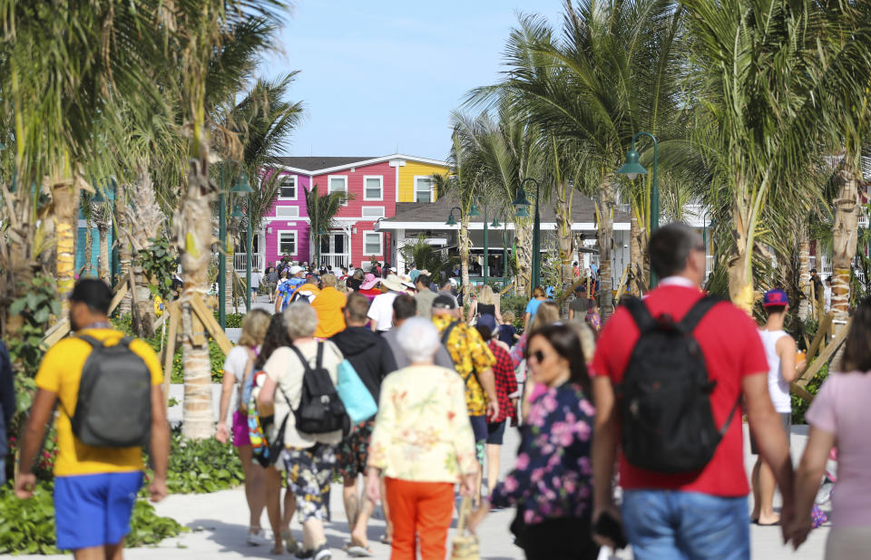 Guests make their way through the welcome plaza to discover Ocean Cay MSC Marine Reserve, Thursday, Dec. 5, 2019 in Marine Cay Island, The Bahamas. (James McEntee/MSC Cruises via AP Images)