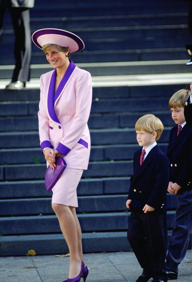 <p>The princess is wearing a bold pink-and-purple suit designed by Catherine Walker. (Photo: Tim Graham/Getty Images) </p>