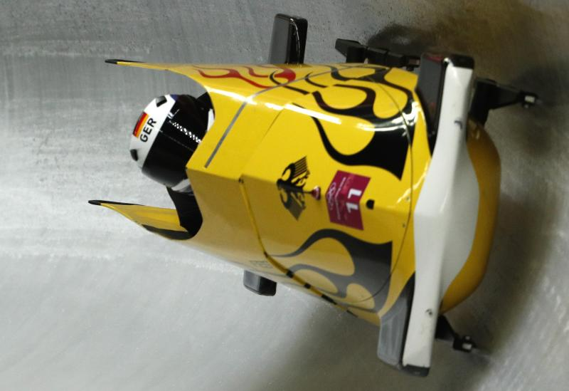 Nico Walther and Christian Poser crashed across the finish line on Sunday to take gold medal position in the second of four bobsled runs. More