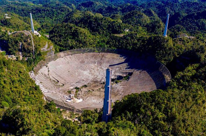 "<span class=""caption"">Once featured in movies, TV shows and video games, the Arecibo Observatory was the pride of Puerto Rico.</span> <span class=""attribution""><a class=""link rapid-noclick-resp"" href=""https://www.gettyimages.com/detail/news-photo/this-aerial-view-shows-the-damage-at-the-arecibo-news-photo/1229890426"" rel=""nofollow noopener"" target=""_blank"" data-ylk=""slk:RICARDO ARDUENGO / Contributor / AFP via Getty Images"">RICARDO ARDUENGO / Contributor / AFP via Getty Images</a></span>"