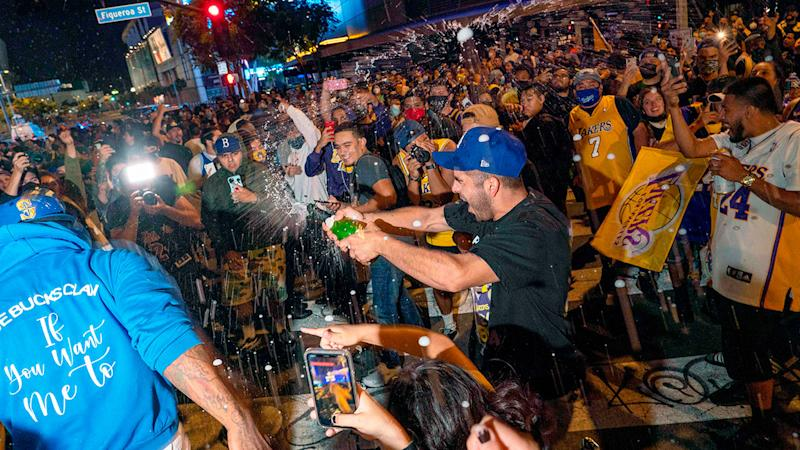As seen here, social distancing was non-existent during the NBA celebrations in Los Angeles.