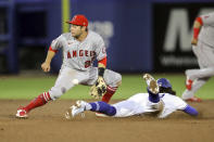 Los Angeles Angels second baseman David Fletcher cannot handle the throw as Toronto Blue Jays' Bo Bichette steals second base during the sixth inning of a baseball game Thursday, April 8, 2021, in Dunedin, Fla. (AP Photo/Mike Carlson)