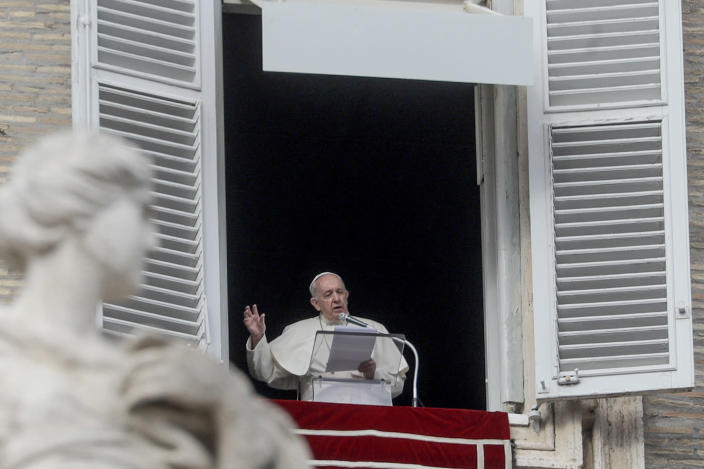 Pope Francis recites the Angelus prayer from his studio window overlooking St.Peter's Square at the Vatican, Sunday, Nov. 29, 2020. Pope Francis, joined by the church's newest cardinals at Mass, has warned against mediocrity as well as promoting one's career rise. (AP Photo/Gregorio Borgia)