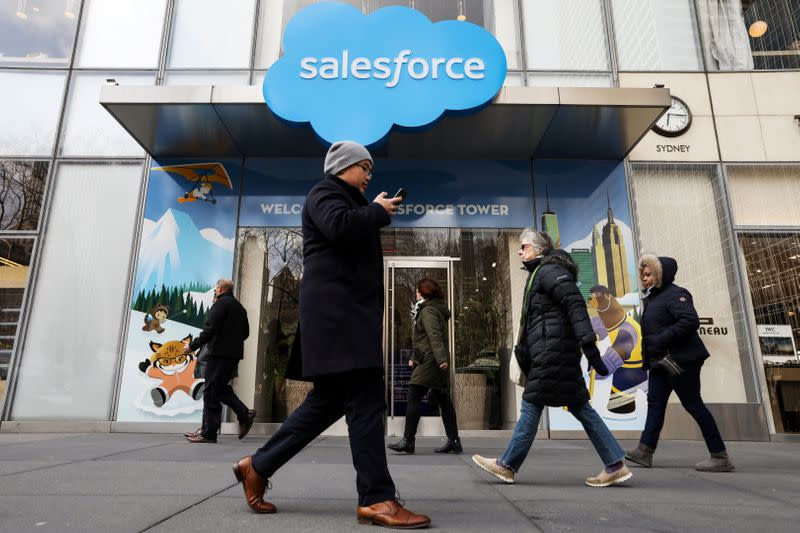 People pass by the Salesforce Tower and Salesforce.com offices in New York