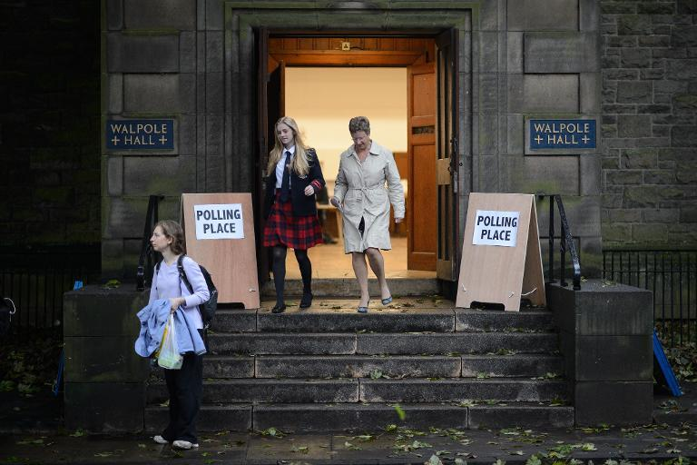 A young voter leaves a polling station after casting her ballot in Edinburgh on September 18, 2014, as voting begins in Scotland's independence referendum (AFP Photo/Leon Neal)