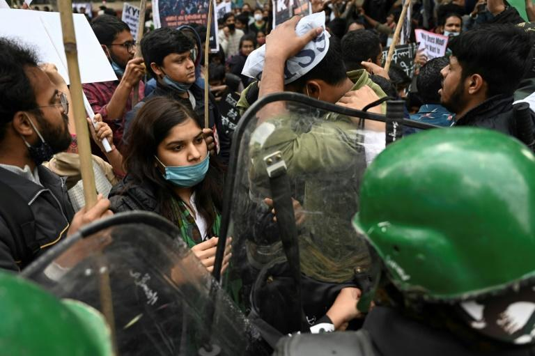 Demonstrators take part in a march organised in support of farmers protesting against government agricultural reforms in New Delhi on February 3, 2021