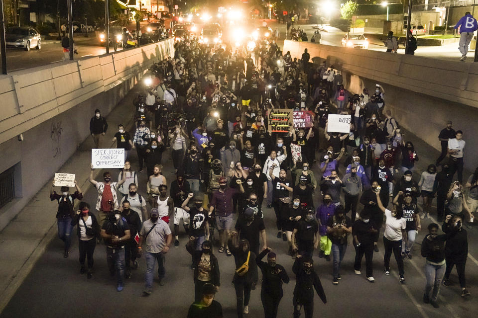 Protesters in Louisville, Ky., on Thursday, following the decision not to charge officers with the killing of Breonna Taylor. (John Minchillo/AP)