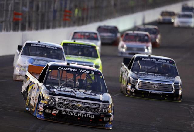 DrJoey Coulter (21) and others make their way around the track during the NASCAR Truck Series auto race at Gateway Motorsports Park on Saturday, June 14, 2014, in Madison, Ill. (AP Photo/Jeff Roberson)