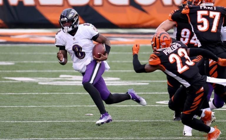 Baltimore quarterback Lamar Jackson runs with the ball in the Ravens' NFL victory over the Cincinnati Bengals