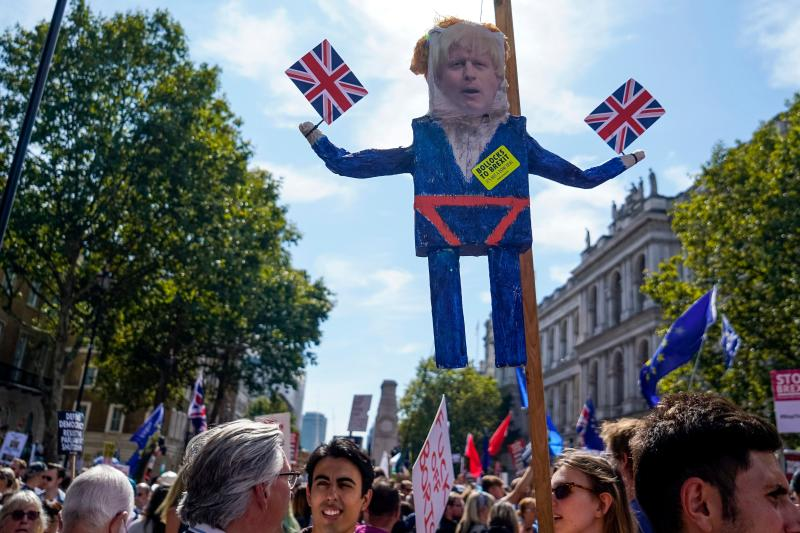 "Demonstrators carry an effigy of Britain's Prime Minister Boris Johnson at a protest against the move to suspend parliament in the final weeks before Brexit outside Downing Street in London on August 31, 2019. - Demonstrations, being dubbed ""Stop The Coup"" by organisers, were to be held across Britain on August 31 against Prime Minister Boris Johnson's move to suspend parliament in the final weeks before Brexit. The protests come ahead of an intense political week in which Johnson's opponents will seek to block the move in court and legislate against a no-deal departure from the European Union. (Photo by Niklas HALLE'N / AFP) (Photo credit should read NIKLAS HALLE'N/AFP/Getty Images)"