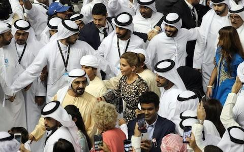 Sheikh Mohammed, centre left, and Princess Haya arrive at the trophy presentation in the Meydan Racecourse in Dubai last year. - Credit: AFP