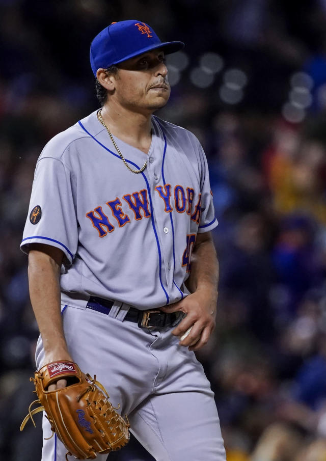 New York Mets relief pitcher Jason Vargas reacts to giving up a two-run home run to Colorado Rockies' Nolan Arenado during the third inning of a baseball game, Tuesday, June 19, 2018, in Denver. (AP Photo/Jack Dempsey)