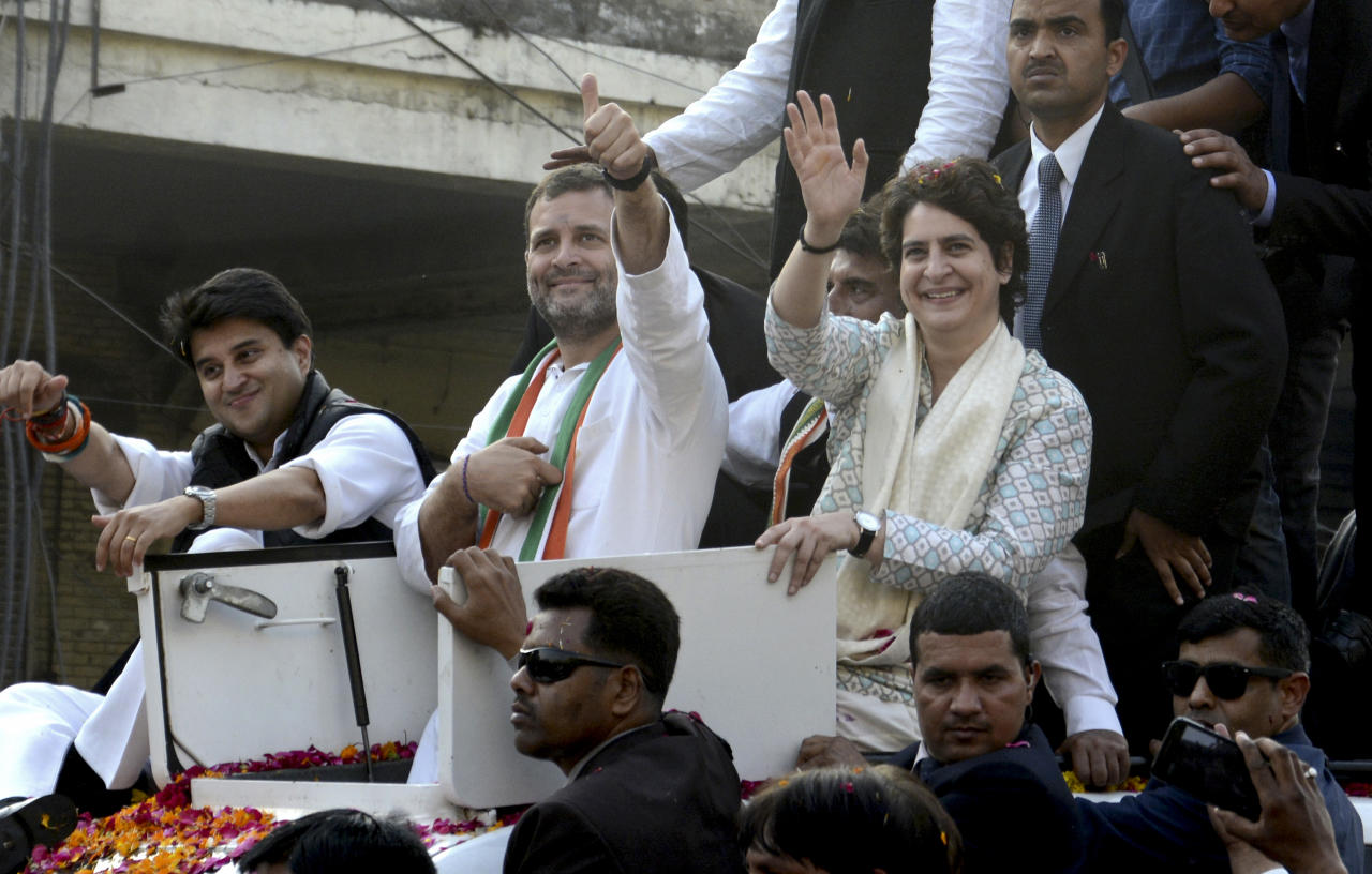 <p>Congress party president Rahul Gandhi, center, gestures as party's general secretaries Priyanka Gandhi Vadra right, and Jyotiraditya Scindia, left wave at supporters during a rally in Lucknow, India, Monday, Feb.11, 2019. (AP Photo/Nirala Tripathi) </p>