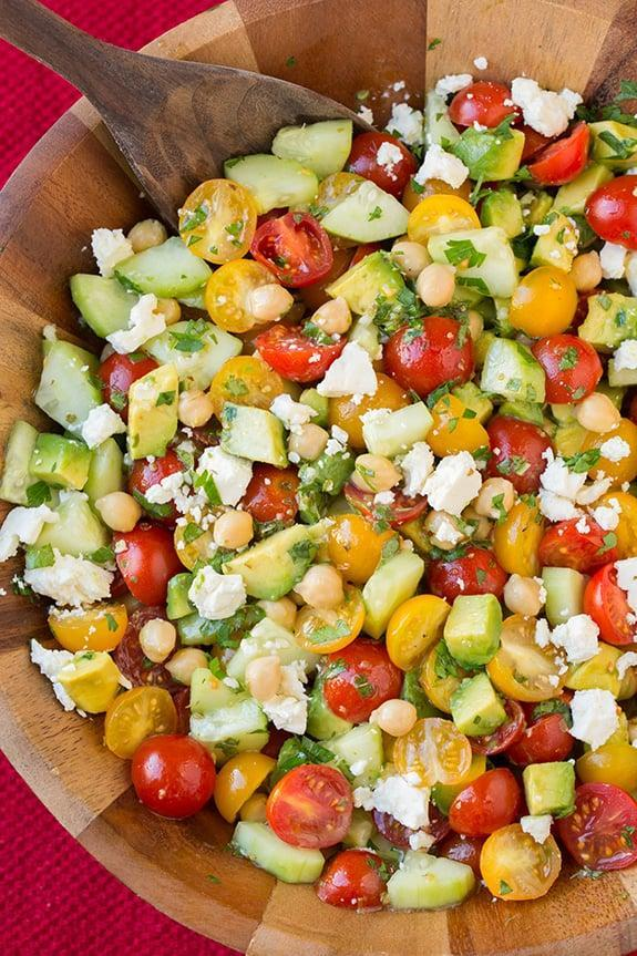 "<p><strong>Get the recipe</strong>: <a href=""http://www.cookingclassy.com/2015/03/tomato-avocado-cucumber-chick-pea-salad-with-feta-and-greek-lemon-dressing/"" class=""link rapid-noclick-resp"" rel=""nofollow noopener"" target=""_blank"" data-ylk=""slk:tomato salad with chickpeas, avocado, and cucumber"">tomato salad with chickpeas, avocado, and cucumber</a></p>"