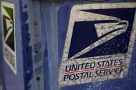 A mailbox stands in Fox Point, Wis., Tuesday, Aug. 18, 2020. Facing public pressure and state lawsuits, the Postmaster general announced Tuesday he is halting some operational changes to mail delivery that critics warned were causing widespread delays and could disrupt voting in the November election. (AP Photo/Morry Gash)