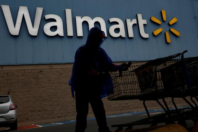 FILE PHOTO: An employee arranges shopping carts in front of the logo of Walmart outside a store in Monterrey, Mexico February 12, 2018. REUTERS/Daniel Becerril/File Photo